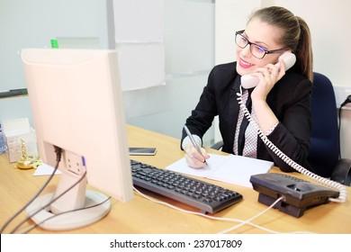Girl secretary in an office