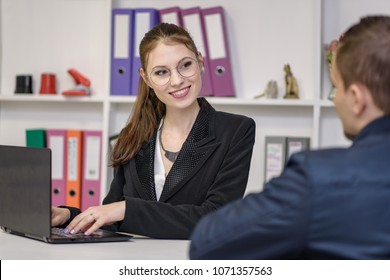girl secretary talking in the office with a client