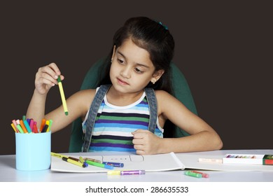Girl selecting colored pen