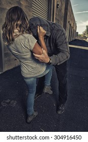 GIRL SELF DEFENSE | A young woman defends herself against a male attacker in an alley. Refuse to be a victim.