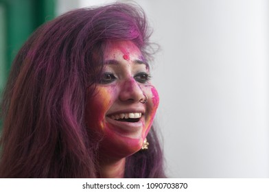 "A girl sharing a smile while being all covered with a colorful powder called ""abeer"" on the occasion of Vasanta Utsav at Jorasanko Thakurbari  on March 2 in 2015 in kolkata , India"