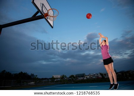 Girl shooting a basketball