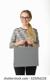 girl with shopping bags on a white background.