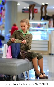 Girl shopping in mall. Shallow depth of field.