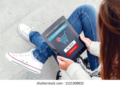 Girl  shopping in online store using a tablet. Online Shopping Concept