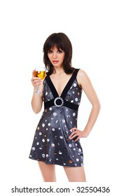 The girl in a short dress with a wine glass in a hand