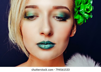 Girl with short hair and green makeup