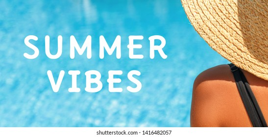 """Girl shoulder with a straw hat an the blue water pool background with """"Summer vibes"""" wording. Summer resort, vacation concept. Wide screen banner format"""