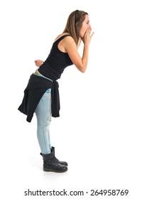 Girl shouting over white background