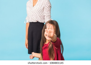 Girl show hand up, symbol of stop. invisible face, a young girl with hand out. body language to say Don't' is concept.