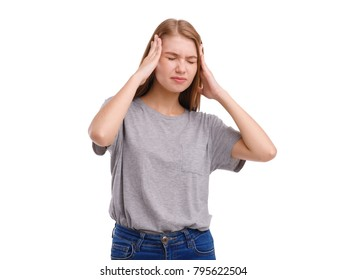 A girl showing a headache holding hands behind head. Isolated on white.