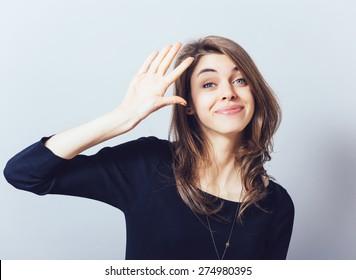 girl showing hello