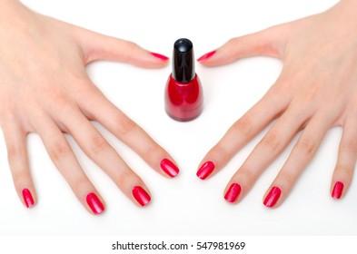 Girl showing her manicured fingernails after manicure in beauty salon.