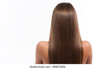 Girl showing her straight brown hair