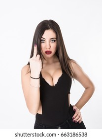 girl showing middle finger, light background