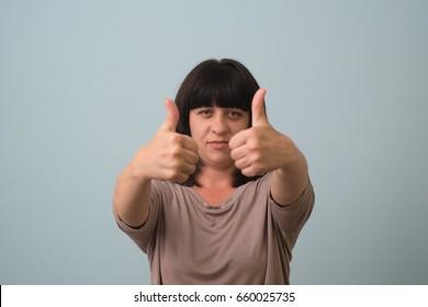 Girl showing thumb up, OK