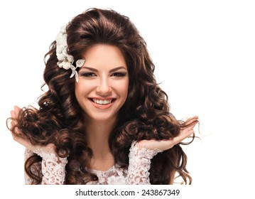 girl shows her beautiful hair. cheerful girl holding her beautiful hair curly