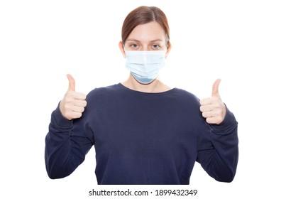 The girl shows how to properly wear a medical mask. Isolated white background
