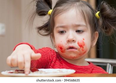 Girl shows on the porridge into bowls