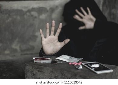 Girl shows palms against drug abuse , The concept of crime and drug addiction. 26 June, International Day Against Drug Abuse and Illicit Trafficking