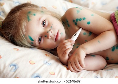 The girl, a sick chickenpox, temperature measurement