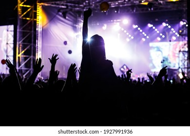 Girl silhouette on a big concert show