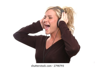 a girl is singing along to a song