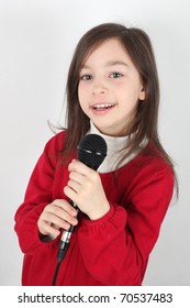Girl is singing with a microphone