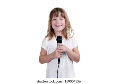 Girl sings with a microphone in hands on a white background