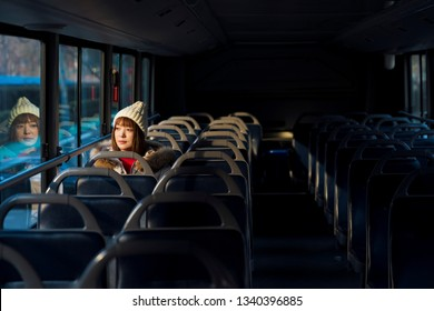 The girl sitting in the bus