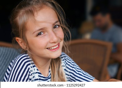 girl is sitting in cafe and waiting for friends