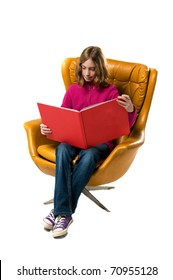 girl sitting in a chair reading a book