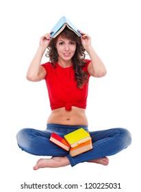 Girl sitting in the floor having fun with books