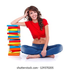 Girl sitting near many colorful books over white background