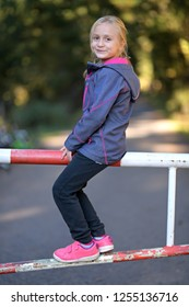 girl  sitting on the barrier