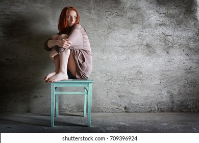 girl sitting on a chair domestic violence victim