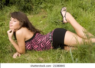 Girl sitting on lawn.