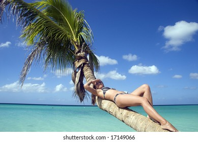 Girl sitting on the palm