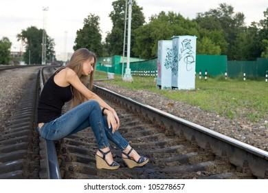 Girl sitting on rails