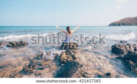 girl sitting on rock facing sea stock photo edit now 421657585