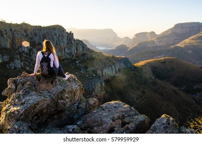 A girl sitting on a rock at Lowveld view in Blyde River Canyon Nature Reserve (Motlatse Canyon Provincial Nature Reserve) in Mpumalanga, Republic South Africa.