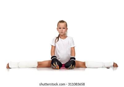 girl sitting on the splits in thai  boxing gloves
