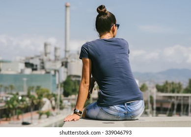 girl sitting on the top of the hill