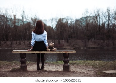 The girl is sitting in the park