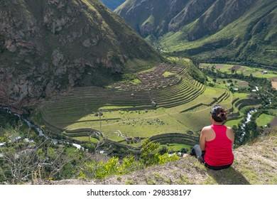 Girl sitting at Pattallacta, Inca ruins of agricultural center,
