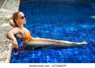 Girl sitting in the pool