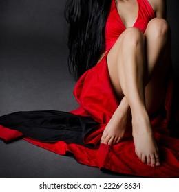 Girl sitting in red dress