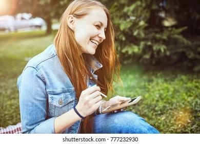girl sitting in the sunny park. picnik