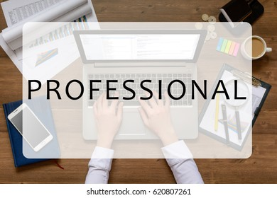 Girl is sitting at table with business accessories, cup of coffee and a laptop, works with drawings, graphs, tables, using laptop with text Professional. Top view.