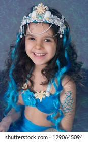 Girl of six years in a mermaid costume